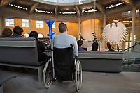 DEU, Deutschland, Germany, Berlin, 01.02.2018: Ein junger Mann im Rollstuhl verfolgt von der Besuchertribüne aus eine Plenarsitzung im Deutschen Bundestag.