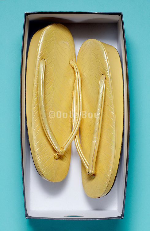 Traditional Japanese footwear called zori to be worn with kimono in a shoe box
