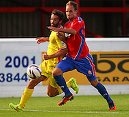 Scott Doe of of Dagenham and Redbridge (right) holds off Will Grigg of Milton Keynes Dons during the Pre Season Friendly match at the London Borough of Barking and Dagenham Stadium, London<br /> Picture by David Horn/Focus Images Ltd +44 7545 970036<br /> 22/07/2014