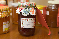 Jar of homemade strawberry jam; produce from the members of Age concern handcrafts,