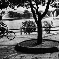 Malaysian cyciling during weekend day at Titiwangsa Lake in Kuala Lumpur, Malaysia.