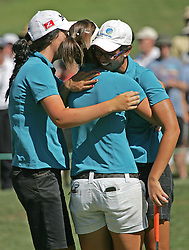 (Canberra, Australia---30 January 2011) (Canberra, Australia---30 January 2011) Ashley Ona (Amateur) of Queensland, Australia is given congratulatory hugs by friends after winning the ActewAgl Royal Canberra Ladies golf tournament as part of the 2011 Australian Ladies Pro Golf Tour./ 2011 Copyright Sean Burges. For Australian editorial sales, contact seanburges@yahoo.com.