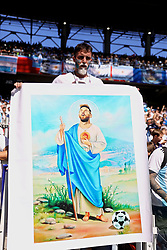 MOSCOW, RUSSIA - Saturday, June 16, 2018: An Argentina supporter with an image of Lionel Messi as Jesus Christ during the FIFA World Cup Russia 2018 Group D match between Argentina and Iceland at the Spartak Stadium. (Pic by David Rawcliffe/Propaganda)