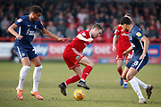 Accrington Stanley midfielder Sean McConville (11) goes past Southend United midfielder Michael Klass (20) and Southend United midfielder Timothee Dieng (8)  during the EFL Sky Bet League 1 match between Accrington Stanley and Southend United at the Fraser Eagle Stadium, Accrington, England on 23 February 2019.