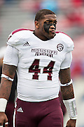 LITTLE ROCK, ARKANSAS - NOVEMBER 23:  Christian Holmes #44 of the Mississippi State Bulldogs warming up before a game against the Arkansas Razorbacks at War Memorial Stadium on November 23, 2013 in Little Rock, Arkansas.  The Bulldogs defeated the Razorbacks 24-17.  (Photo by Wesley Hitt/Getty Images) *** Local Caption *** Christian Holmes