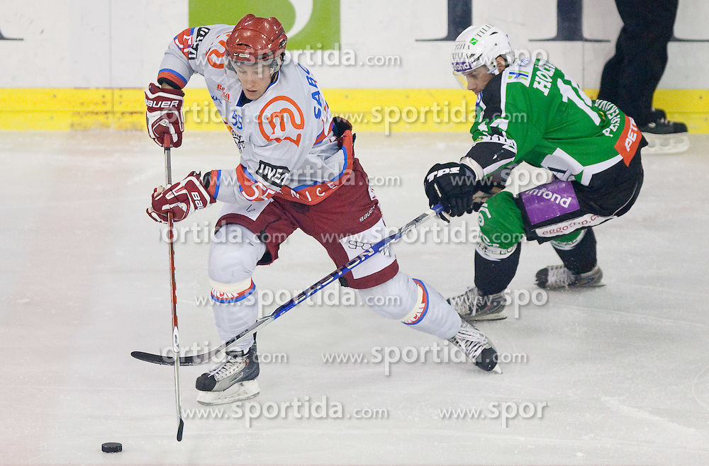 Robert Sabolic of Jesenice vs Matej Hocevar of Olimpija during ice-hockey match between HDD Tilia Olimpija and HK Acroni Jesenice in 26th Round of EBEL league, on December 10, 2010 at Hala Tivoli, Ljubljana, Slovenia.(Photo By Vid Ponikvar / Sportida.com)