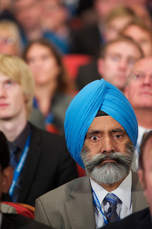 Delegates listen to speeches on the second day of the Conservatives Party Conference at the ICC, Birmingham, UK on October 4, 2010.  This is the first conference since the government coalition with the Liberal Democrats.