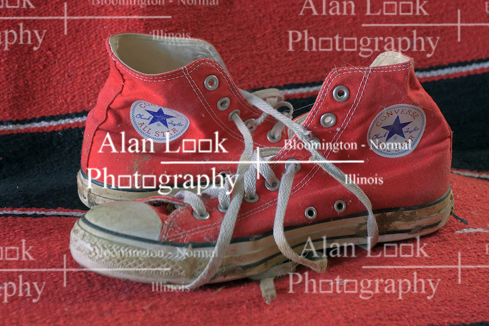 17 December 2011:   Shoes or boots on a saddle blanket.  A pair of dirty Converse All Star sneakers. This image is a result of the High Dynamic Range (HDR) process. If used editorially, it must be captioned as an illustration This image available for EDITORIAL USE ONLY. A release may be required. Additional information by contacting alook at alanlook.com