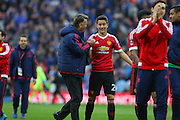 Manchester United Manager Louis van Gaal jokes with Ander Herrera of Manchester United during the The FA Cup semi final match between Everton and Manchester United at Wembley Stadium, London, England on 23 April 2016. Photo by Phil Duncan.