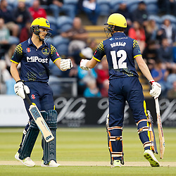 Glamorgan's Craig Meschede celebrates a boundary with team-mate Aneurin Donald<br /> <br /> Photographer Simon King/Replay Images<br /> <br /> Vitality Blast T20 - Round 14 - Glamorgan v Surrey - Friday 17th August 2018 - Sophia Gardens - Cardiff<br /> <br /> World Copyright © Replay Images . All rights reserved. info@replayimages.co.uk - http://replayimages.co.uk