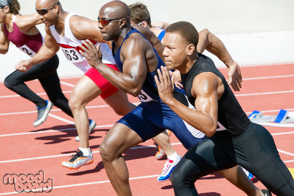 Male athletics sprinting on running track