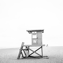 Newport Beach Lifeguard Tower W black and white photo. The Wedge is a popular surf spot in Orange County Southern California in the United States of America. Photo Copyright ⓒ 2010 Paul Velgos with All Rights Reserved.