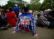 "© Licensed to London News Pictures. 05/06/2012. London, UK. A man wears a jacket saying 'Great Britain"" to watch the Jubilee Procession on the Mall today 5th June 2012.  The Royal Jubilee celebrations. Great Britain is celebrating the 60th  anniversary of the countries Monarch HRH Queen Elizabeth II accession to the throne this weekend Photo credit : Stephen Simpson/LNP"
