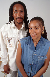 Portrait of couple standing together smiling,