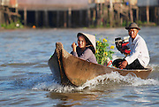 "CAI BE, VIETNAM - FEBRUARY 16, 2007: Unidentified senior couple cross Mekong river by motorboat in Cai Be, Vietnam. Cai Be is often called the ""Venice of Indochina""."