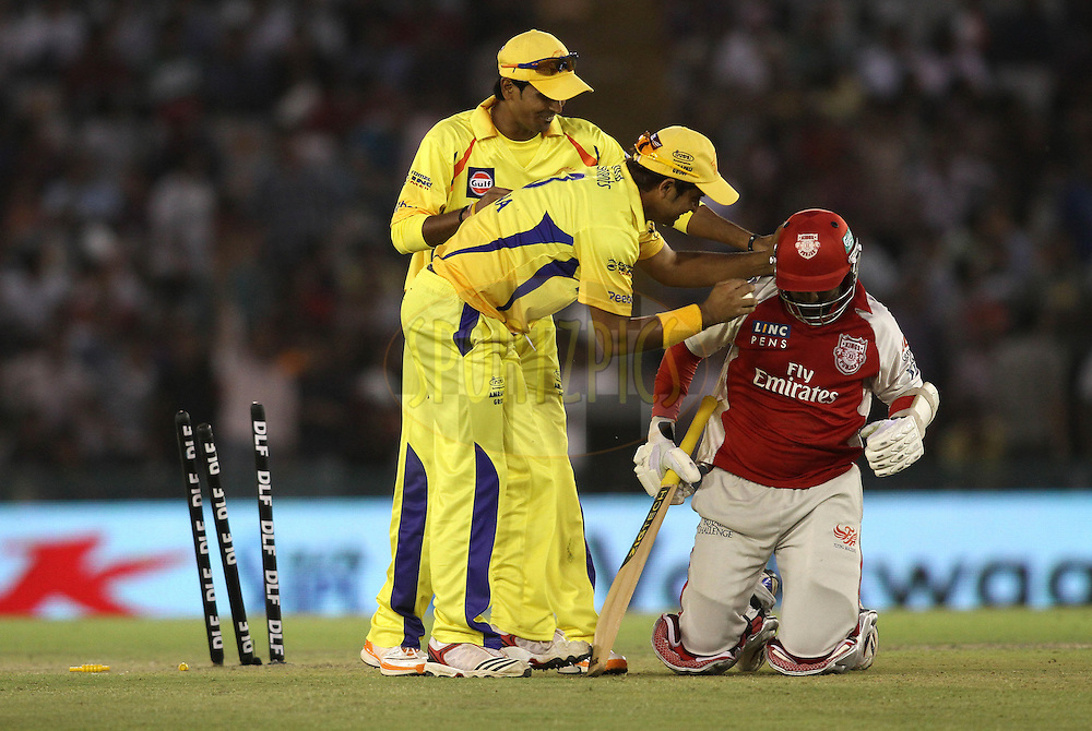 Subramaniam Badrinath of the Chennai Super Kings and Suresh Raina of the Chennai Super Kings help Dinesh Karthik of the Kings XI Punjab after clashing together during match 9 of the Indian Premier League ( IPL ) Season 4 between the Kings XI Punjab and the Chennai Super Kings held at the PCA stadium in Mohali, Chandigarh, India on the 13th April 2011..Photo by Shaun Roy/BCCI/SPORTZPICS