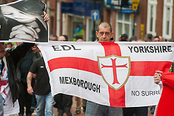 "Rotherham England<br /> 13 September 2014 <br /> Local EDL supporter from Mexbrough in Yorkshire aproaches Rotherham Town Hall before the start of the English Defence Leagues Justice for the Rotherham 1400 March on Saturday Afternoon described by an EDL Facebook Page as ""a protest against the Pakistani Muslim grooming gangs"" on Saturday Afternoon <br /> <br /> <br /> Image © Paul David Drabble <br /> www.pauldaviddrabble.co.uk"