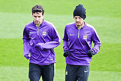 Jesus Navas & David Silva pictured during the training session at The Etihad Campus ahead of the UEFA Champions League clash with FC Barcelona - Photo mandatory by-line: Matt McNulty/JMP - Mobile: 07966 386802 - 23/02/2015 - SPORT - Football - Manchester - Etihad Stadium