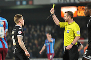Max Power of Wigan Athletic ewcievws tellow card during the Sky Bet League 1 match between Scunthorpe United and Wigan Athletic at Glanford Park, Scunthorpe, England on 2 January 2016. Photo by Ian Lyall.