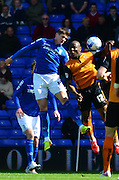 Goalscorers Benik Afobe and Rob Kiernan challenge for the ball during the Sky Bet Championship match between Birmingham City and Wolverhampton Wanderers at St Andrews, Birmingham, England on 11 April 2015. Photo by Alan Franklin.