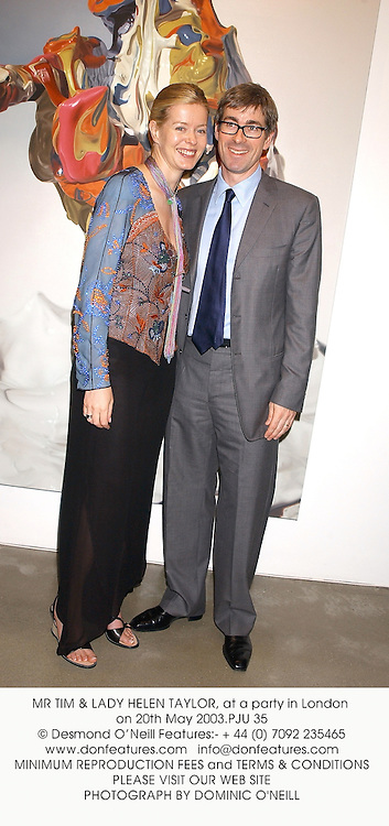 MR TIM & LADY HELEN TAYLOR, at a party in London on 20th May 2003.PJU 35