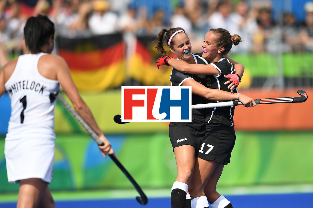 Germany's Pia-Sophie Oldhafer (2L) celebrates scoring a goal with Germany's Jana Teschke during the women's field hockey New Zealand vs Germany match of the Rio 2016 Olympics Games at the Olympic Hockey Centre in Rio de Janeiro on August, 8 2016. / AFP / MANAN VATSYAYANA        (Photo credit should read MANAN VATSYAYANA/AFP/Getty Images)