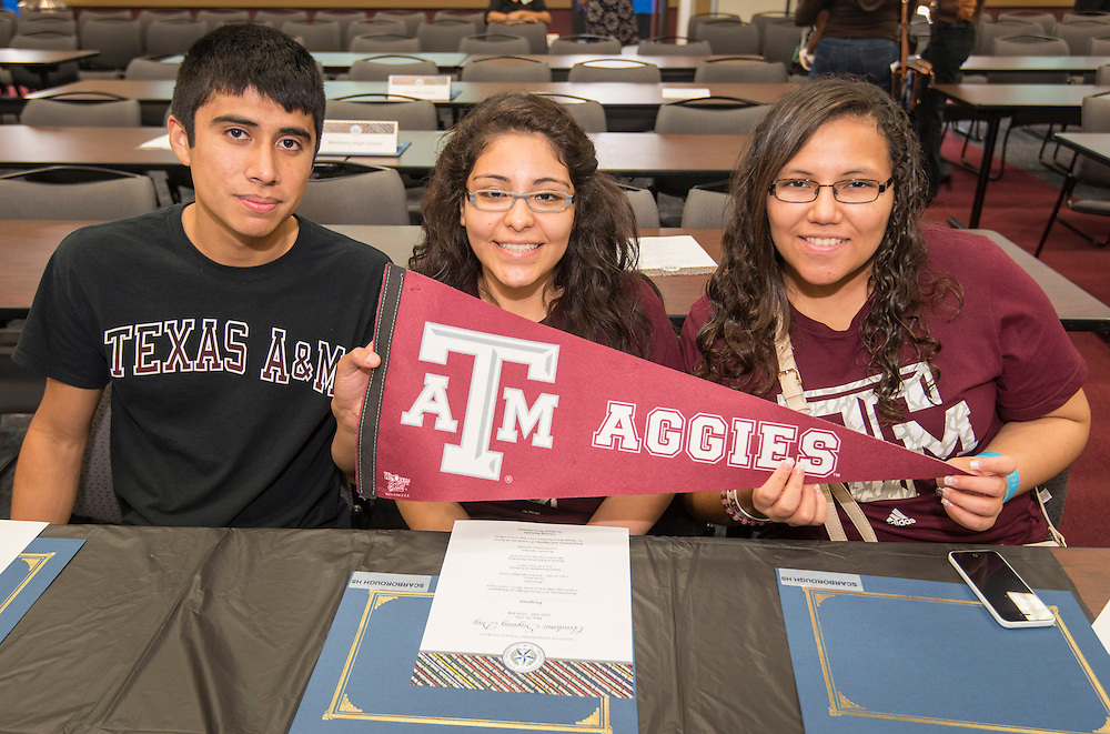 Texas A&M University bound Scarborough High School students pose for a photograph during the Academic Signing Day activities at the Region 4 Education Center, May 23, 2014.