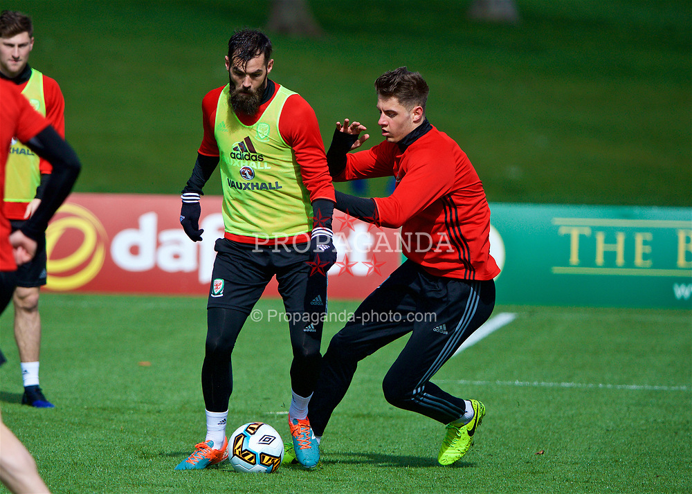 CARDIFF, WALES - Tuesday, March 21, 2017: Wales' Joe Ledley and Joe Rodon during a training session at the Vale Resort ahead of the 2018 FIFA World Cup Qualifying Group D match against Republic of Ireland. (Pic by David Rawcliffe/Propaganda)