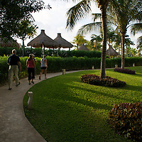 Four people going on morning walk at Mexican resort.