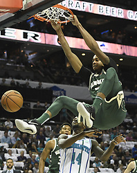 October 17, 2018 - Charlotte, NC, USA - The Milwaukee Bucks' John Henson (31) dunks past the Charlotte Hornets' Michael Kidd-Gilchrist (14) during the first half at the Spectrum Center in Charlotte, N.C., on Wednesday, Oct. 17, 2018. (Credit Image: © David T. Foster Iii/Charlotte Observer/TNS via ZUMA Wire)