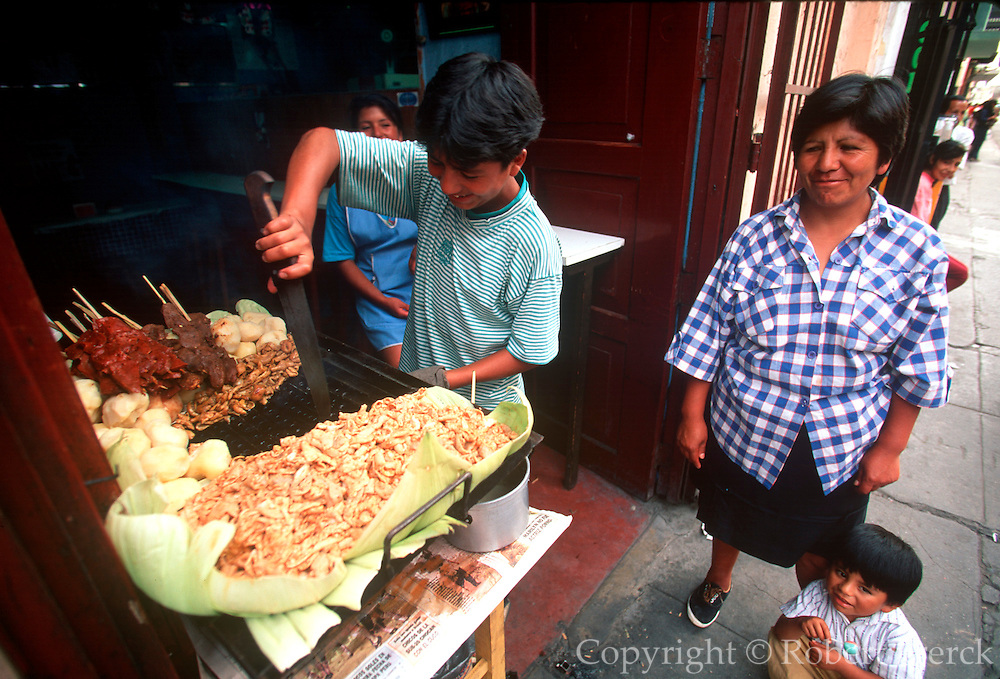 PERU, LIMA, COLONIAL ARCHITECTURE sidewalk shop serving grilled meat near the Plaza de Armas in the colonial section of the city