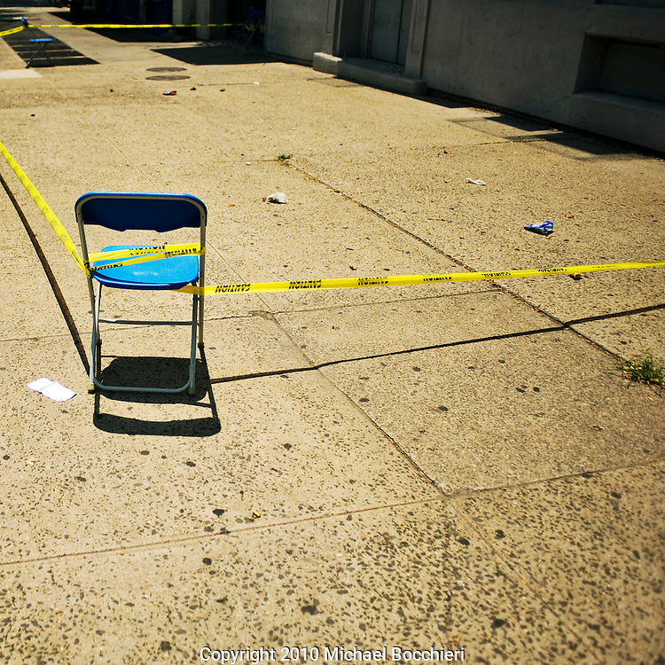 NEW YORK, NY - June 29:  Caution tape around chairs on a sidewalk on 6th Avenue in Manhattan on June 29, 2010 in NEW YORK, NY.  (Photo by Michael Bocchieri/Bocchieri Archive)