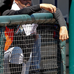 March 26, 2012; Lakeland, FL, USA; Miami Marlins manager Ozzie Guillen (13) stands in the dugout before a spring training game against the Detroit Tigers at Joker Marchant Stadium. Mandatory Credit: Derick E. Hingle-US PRESSWIRE