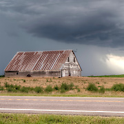 Old barn along Highway 281 and SE 50th Road in southern Kansas prior to a thunderstorm, afternoon of June 24, 2014.