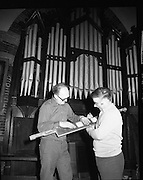 Pipe Organ Dismantling at Aungier Street.  (K86).1977..01.02.1977..02.01.1977..1st February 1977..A pipe organ built around 100 years ago for St Peter's Church (Church of Ireland),at Whitefriar / Aungier Street was being dismantled by Mr Gerry Smith and Mr Sam Wright of Dublin Organ Works. The organ was being dismantled for transfer to St Michael's Church,(Roman Catholic),in Blackrock,Co Cork.