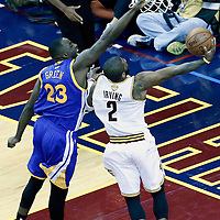 08 June 2016: Cleveland Cavaliers guard Kyrie Irving (2) goes for the layup past Golden State Warriors forward Draymond Green (23) during the Cleveland Cavaliers 120-90 victory over the Golden State Warriors, during Game Three of the 2016 NBA Finals at the Quicken Loans Arena, Cleveland, Ohio, USA.