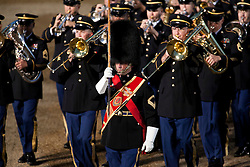 © Licensed to London News Pictures. LONDON, UK  09/06/11. The band leader of the US Army Europe Band and Chorus, performing as a guest band at this years Beating the Retreat, leads his musicians off Horse Guards Parade. On two successive evenings each year in June a pageant of military music, precision drill and colour takes place on Horse Guards Parade in the heart of London when the Massed Bands of the Household Division carry out the Ceremony of Beating Retreat. 300 musicians, drummers and pipers perform this age-old ceremony. The Retreat has origins in the early days of chivalry when beating or sounding retreat pulled a halt to the days fighting. Please see special instructions. Photo credit should read Matt Cetti Roberts/LNP. Please see special instructions for usage rates. Photo credit should read Matt Cetti-Roberts/LNP