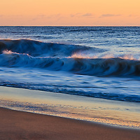 Waves break on the beach of Chincoteague National Wildlife Refuge at sunrise, Assateague Island, Virginia.