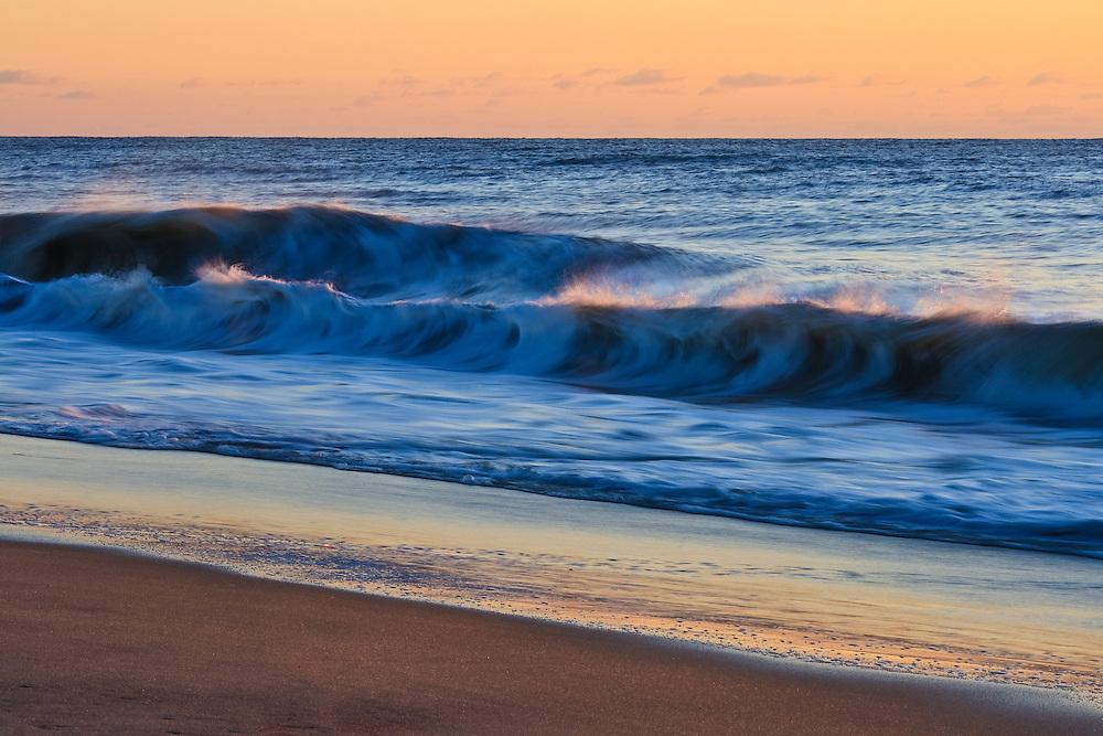 Waves break on the beach of Chincoteague National Wildlife Refuge at sunrise, Assateague Island, Virginia.