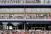 Crowds of spectators assemble on the Royal Stand at Ascot on 17th June 2010 to watch Queen Elizabeth II arrive for Ladies Day at the world famous racecourse. © under license to London News Pictures.