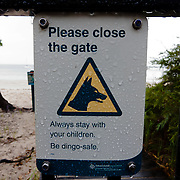 Frazer Island, on the east coast of Australia, is a sand island. Dingo warning sign.