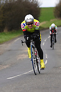 United Kingdom, Finchingfield, Mar 27, 2010:  Stewart Fung, Redbridge CC, approaches the 4 miles to go marker during the 2010 edition of the 'Jim Perrin' Memorial Hardriders 25.5 mile Sporting TT promoted by Chelmer Cycling Club. Copyright 2010 Peter Horrell.
