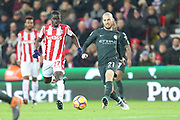 Badou Ndiaya and David Silva during the Premier League match between Stoke City and Manchester City at the Bet365 Stadium, Stoke-on-Trent, England on 12 March 2018. Picture by Graham Holt.