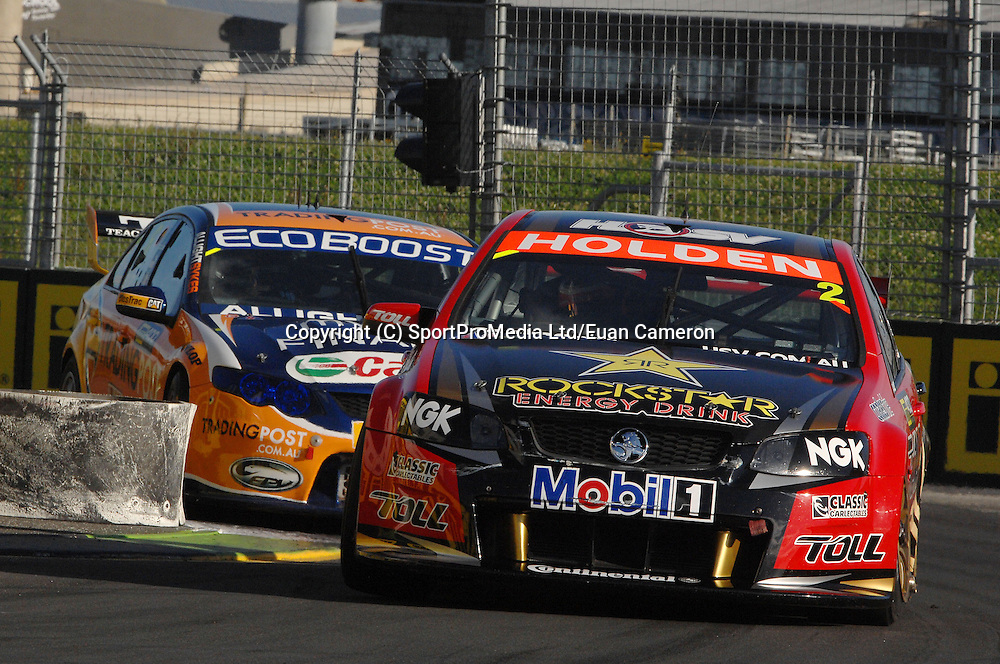 Garth Tander from Melbourne, in his Holden leads Will Davison during Race 1, on Saturday 21th April at the ITM 400 at Hamilton.