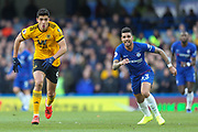 Wolverhampton Wanderers forward Raul Jimenez (9) and Chelsea defender Emerson Palmieri (33) chase possession during the Premier League match between Chelsea and Wolverhampton Wanderers at Stamford Bridge, London, England on 10 March 2019.