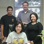 SHMSTC seniors Giovanni Figueroa and Emily Duarte pose with counselor Ana Zamarippa and debate coach Ken Ogden.