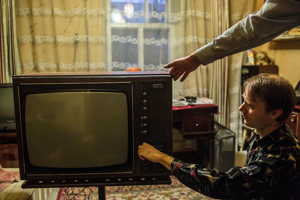 LUHANSK, UKRAINE - MARCH 15, 2015: Aleksandr Kryukov with an old Soviet television he will repair in Luhansk, Ukraine. CREDIT: Brendan Hoffman for The New York Times