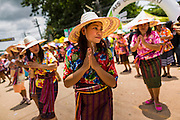 28 JUNE 2014 - DAN SAI, LOEI, THAILAND: Women perform traditional Thai folk dances in the Ghost Festival parade in Dan Sai. Phi Ta Khon (also spelled Pee Ta Khon) is the Ghost Festival. Over three days, the town's residents invite protection from Phra U-pakut, the spirit that lives in the Mun River, which runs through Dan Sai. People in the town and surrounding villages wear costumes made of patchwork and ornate masks and are thought be ghosts who were awoken from the dead when Vessantra Jataka (one of the Buddhas) came out of the forest.    PHOTO BY JACK KURTZ