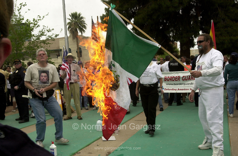 Protesters and counter protesters participated in a demonstration against immigration legislation attended by about 15,000 on April 10, 2006, at Armory Park in Tucson, Arizona, USA.  Counter protesters, Roy Warden, left, and Russ Dove, burn the flag of Mexico.