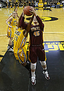 February 10 2011: Iowa Hawkeyes guard Kachine Alexander (21) and Minnesota Golden Gophers forward Jackie Voigt (45) battle for a rebound during the first half of an NCAA women's college basketball game at Carver-Hawkeye Arena in Iowa City, Iowa on February 10, 2011. Iowa defeated Minnesota 64-62.